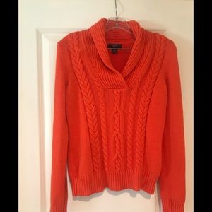 Orange cable knit sweater.